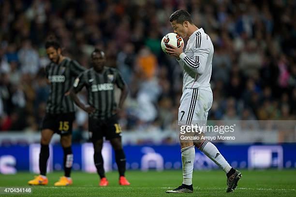 Cristiano Ronaldo of Real Madrid CF kisses the ball before striking a penalty shot during the La Liga match between Real Madrid CF and Malaga CF at...