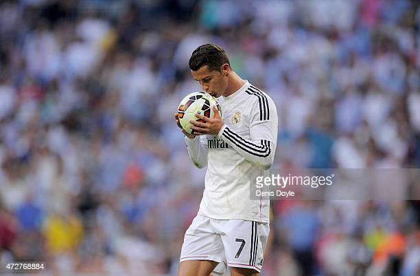 Cristiano Ronaldo of Real Madrid CF kisses the ball before taking a penalty kick during the La Liga match between Real Madrid CF and Valencia CF at...