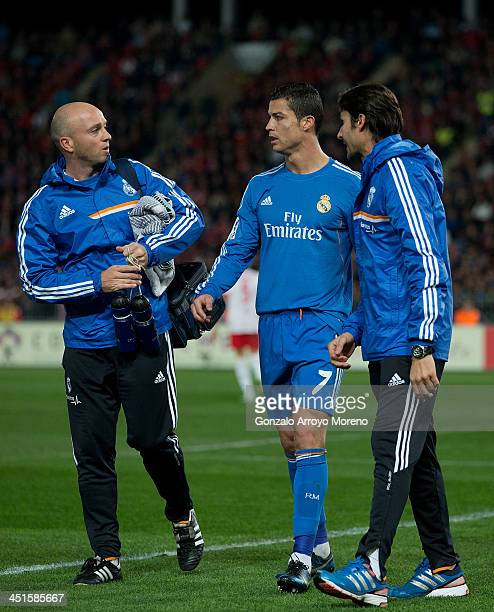 Cristiano Ronaldo of Real Madrid CF leaves the pitch after a pain surrounded by Real Madrid medical staff during the La Liga match between UD Almeria...