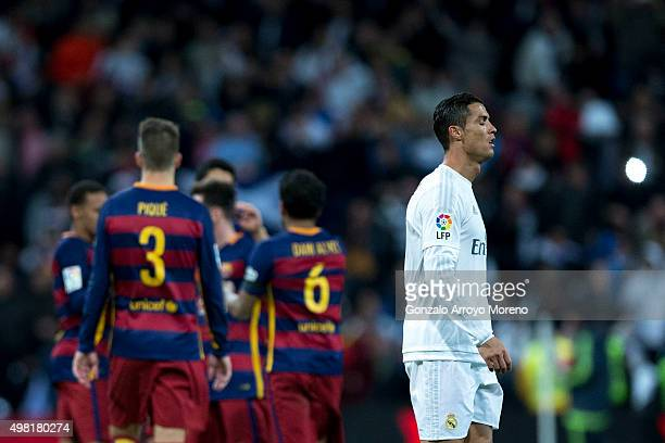 Cristiano Ronaldo of Real Madrid CF leaves the pithc as FC Barcelona players celebrate their victory after the La Liga match between Real Madrid CF...