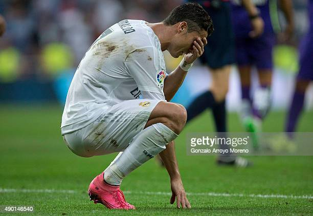 Cristiano Ronaldo of Real Madrid CF looks dejected after the La Liga match between Real Madrid CF and Malaga CF at Estadio Santiago Bernabeu on...