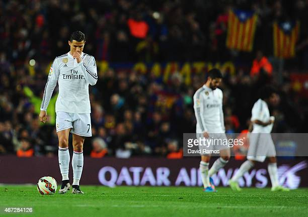 Cristiano Ronaldo of Real Madrid CF looks dejected during the La Liga match between FC Barcelona and Real Madrid CF at Camp Nou on March 22 2015 in...