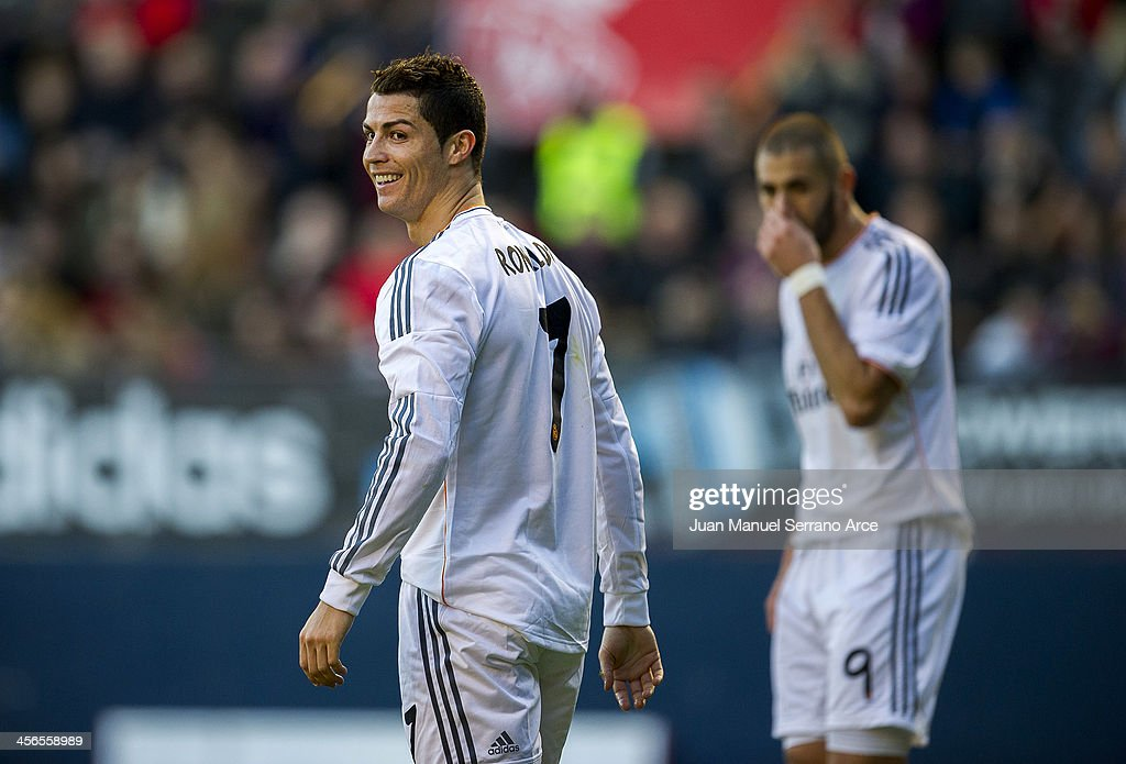 <a gi-track='captionPersonalityLinkClicked' href=/galleries/search?phrase=Cristiano+Ronaldo+-+Soccer+Player&family=editorial&specificpeople=162689 ng-click='$event.stopPropagation()'>Cristiano Ronaldo</a> of Real Madrid CF looks on during the La Liga match between CA Osasuna and Real Madrid CF at Estadio Reyno de Navarra on December 14, 2013 in Pamplona, Spain.