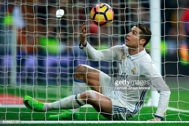 Cristiano Ronaldo of Real Madrid CF picks the ball after scoring their second goal during the La Liga match between Real Madrid CF and UD Las Palmas...