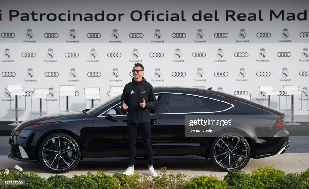 Cristiano Ronaldo of Real Madrid CF poses for a photograph after being presented with a new Audi car as part of an ongoing sponsorship deal with Real Madrid at their Ciudad Deportivo training grounds on November 23, 2017 in Madrid, Spain.