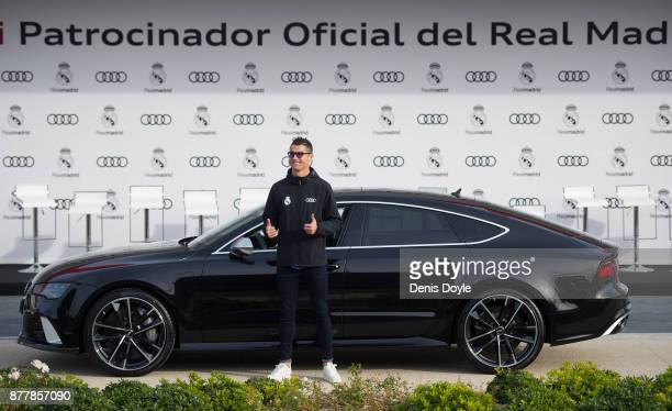 Cristiano Ronaldo of Real Madrid CF poses for a photograph after being presented with a new Audi car as part of an ongoing sponsorship deal with Real...
