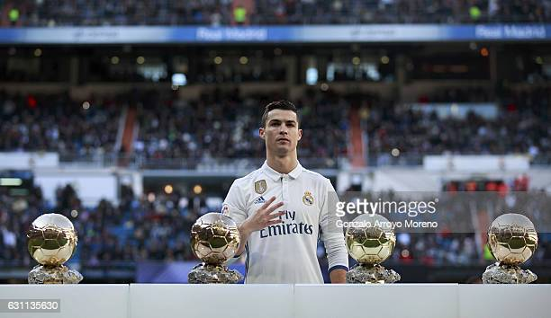 Cristiano Ronaldo of Real Madrid CF poses with his four Golden Balls prior to start the La Liga match between Real Madrid CF and Granada CF at...