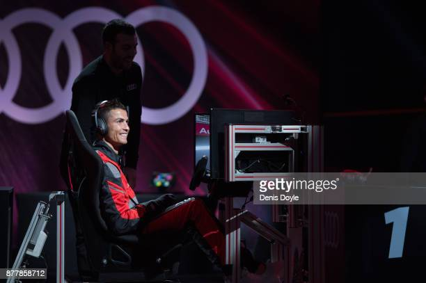 Cristiano Ronaldo of Real Madrid CF races in his simulated Formulae car during a race with his teammates during the Audi Handover Sponsorship deal...