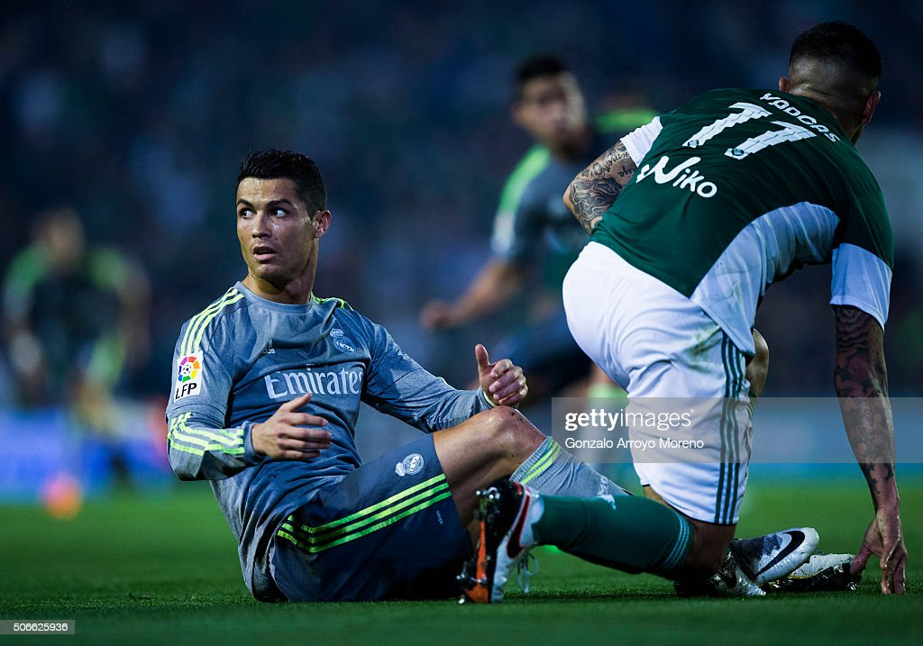 <a gi-track='captionPersonalityLinkClicked' href=/galleries/search?phrase=Cristiano+Ronaldo+-+Soccer+Player&family=editorial&specificpeople=162689 ng-click='$event.stopPropagation()'>Cristiano Ronaldo</a> of Real Madrid CF reacts after being tackled by Juan Manuel Vargas (R) of Real Betis Balompie during the La Liga match between Real Betis Balompie and Real Madrid CF at Estadio Benito Villamarin on January 24, 2016 in Seville, Spain.