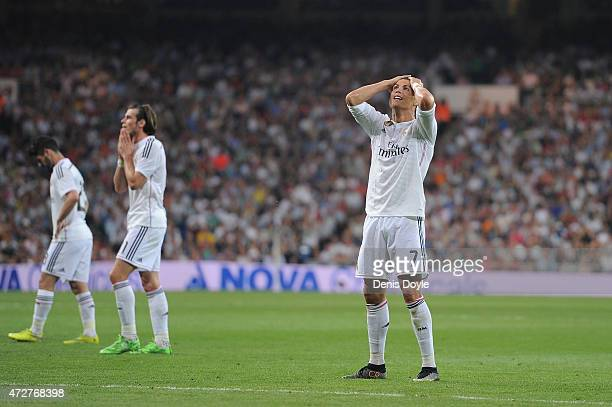 Cristiano Ronaldo of Real Madrid CF reacts after failing to score from a free kick during the La Liga match between Real Madrid CF and Valencia CF at...