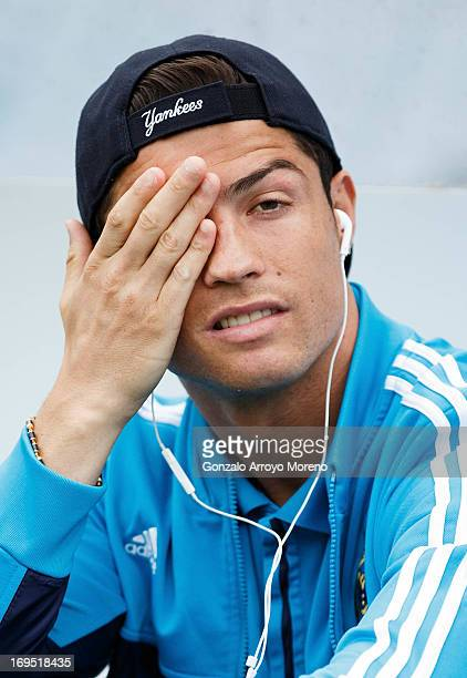 Cristiano Ronaldo of Real Madrid CF reacts annoyed while listen to music with headphones prior to start the La Liga match between Real Sociedad de...