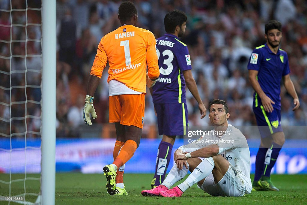 <a gi-track='captionPersonalityLinkClicked' href=/galleries/search?phrase=Cristiano+Ronaldo+-+Soccer+Player&family=editorial&specificpeople=162689 ng-click='$event.stopPropagation()'>Cristiano Ronaldo</a> (2ndR) of Real Madrid CF reacts as he fail to score close to goalkeeper <a gi-track='captionPersonalityLinkClicked' href=/galleries/search?phrase=Idriss+Carlos+Kameni&family=editorial&specificpeople=689971 ng-click='$event.stopPropagation()'>Idriss Carlos Kameni</a> (L) of Malaga CF and his teammate Miguel Torres (2ndL) he La Liga match between Real Madrid CF and Malaga CF at Estadio Santiago Bernabeu on September 26, 2015 in Madrid, Spain.