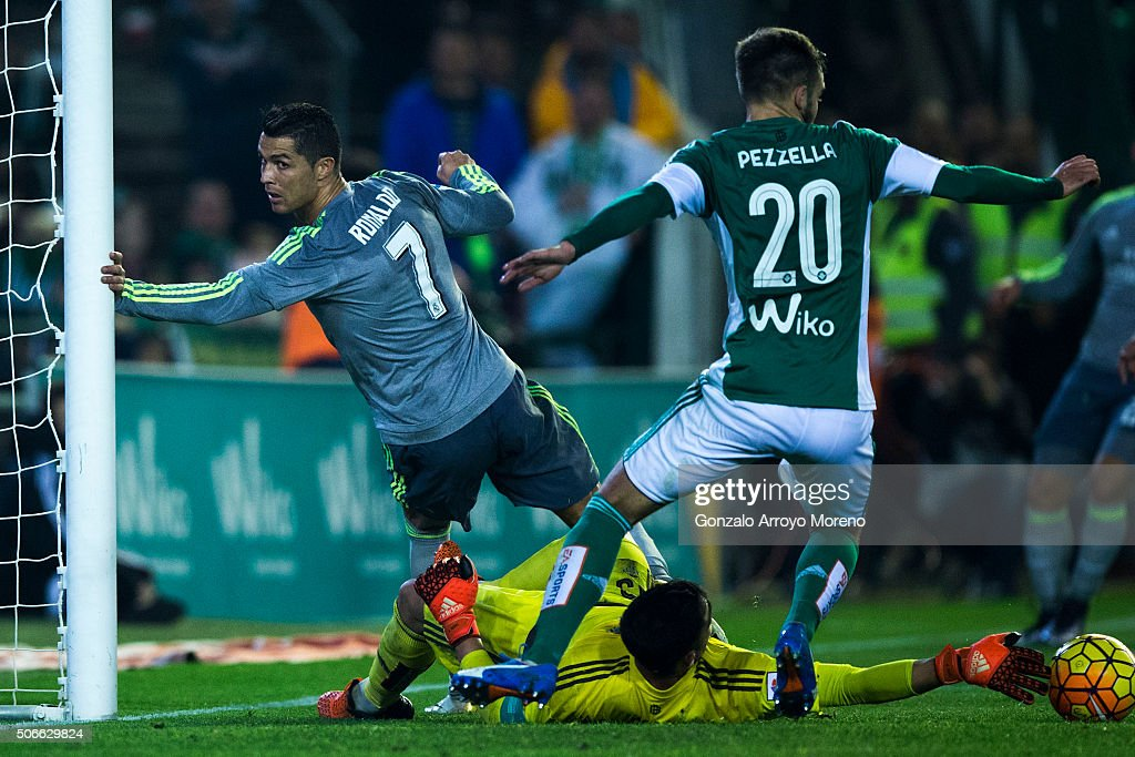 <a gi-track='captionPersonalityLinkClicked' href=/galleries/search?phrase=Cristiano+Ronaldo+-+Soccer+Player&family=editorial&specificpeople=162689 ng-click='$event.stopPropagation()'>Cristiano Ronaldo</a> (L) of Real Madrid CF reacts as he fail to score against goalkeeper Antonio Adan (R) of Real Betis Balompie and his teammate German Pezzella (2ndR) during the La Liga match between Real Betis Balompie and Real Madrid CF at Estadio Benito Villamarin on January 24, 2016 in Seville, Spain.