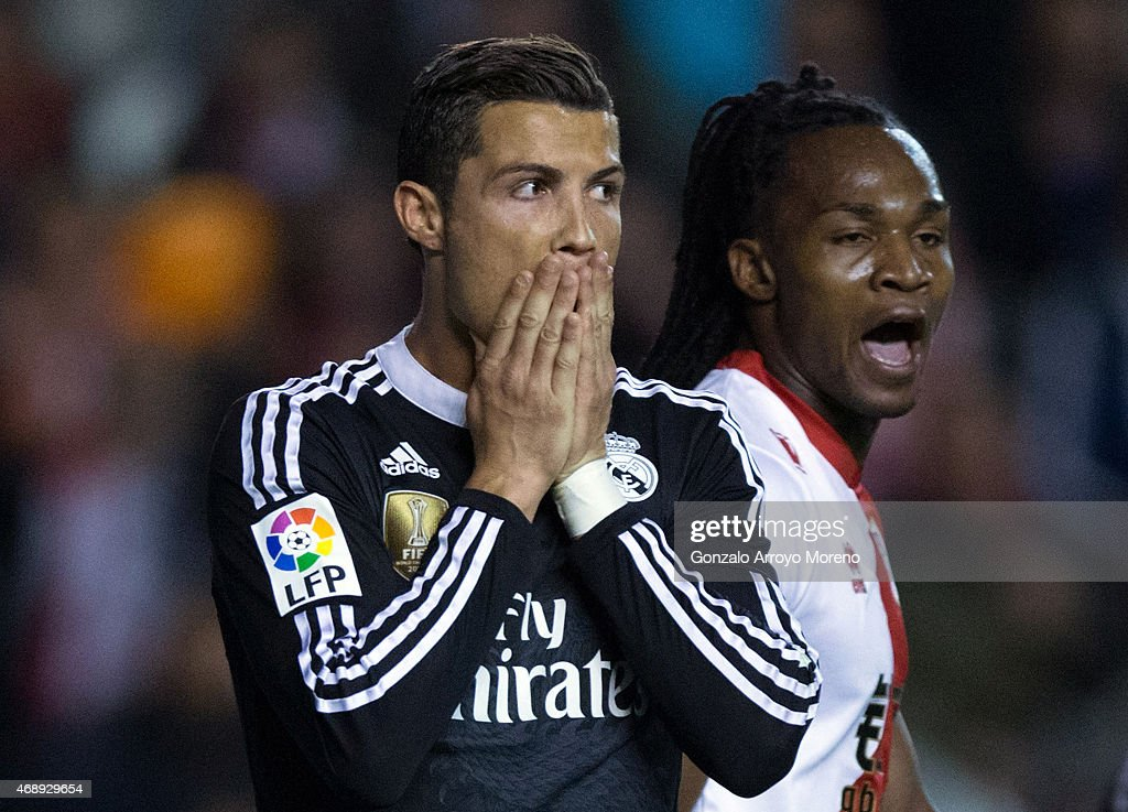 <a gi-track='captionPersonalityLinkClicked' href=/galleries/search?phrase=Cristiano+Ronaldo+-+Soccer+Player&family=editorial&specificpeople=162689 ng-click='$event.stopPropagation()'>Cristiano Ronaldo</a> (L) of Real Madrid CF reacts as his team fails to score close to Mateus Alberto Contreiras alias Manucho (R) of Rayo Vallecano de Madrid during the La Liga match between Rayo Vallecano de Madrid and Real Madrid CF at Vallecas Stadium on April 8, 2015 in Madrid, Spain.