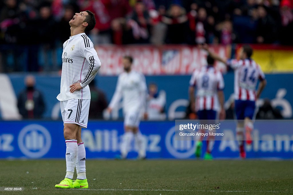 <a gi-track='captionPersonalityLinkClicked' href=/galleries/search?phrase=Cristiano+Ronaldo+-+Soccer+Player&family=editorial&specificpeople=162689 ng-click='$event.stopPropagation()'>Cristiano Ronaldo</a> of Real Madrid CF reacts defeated as behind <a gi-track='captionPersonalityLinkClicked' href=/galleries/search?phrase=Mario+Mandzukic&family=editorial&specificpeople=4476149 ng-click='$event.stopPropagation()'>Mario Mandzukic</a> of Atletico de Madrid celebrates scoring their fourth goal with teammates during the La Liga match between Club Atletico de Madrid and Real Madrid CF at Vicente Calderon Stadium on February 7, 2015 in Madrid, Spain.