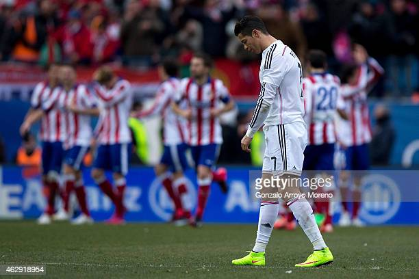 Cristiano Ronaldo of Real Madrid CF reacts defeated as behind Mario Mandzukic of Atletico de Madrid celebrates scoring their fourth goal with...