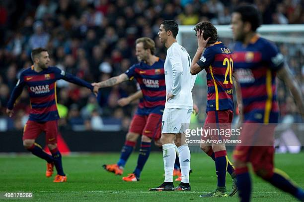 Cristiano Ronaldo of Real Madrid CF reacts defeated as FC Barcelona players celebrate their third goal during the La Liga match between Real Madrid...