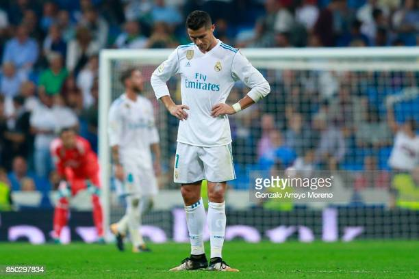 Cristiano Ronaldo of Real Madrid CF recats as Real Betis Balompie players celebrate their first goal during the La Liga match between Real Madrid CF...