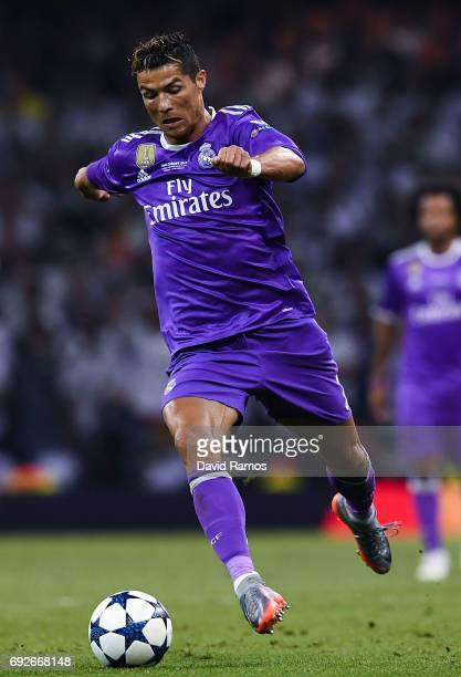 Cristiano Ronaldo of Real Madrid CF runs with the ball during the UEFA Champions League Final between Juventus and Real Madrid at National Stadium of...