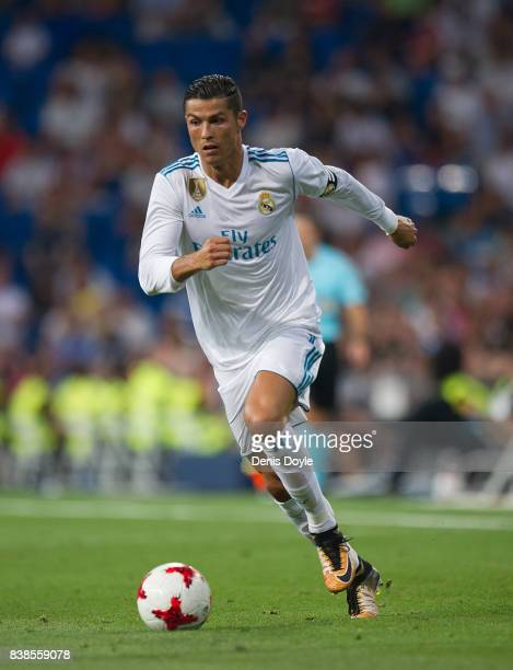 Cristiano Ronaldo of Real Madrid CF runs with the ball during the Santiago Bernabeu Trophy match between Real Madrid CF and ACF Fiorentina at Estadio...