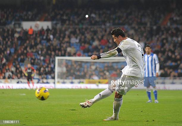 Cristiano Ronaldo of Real Madrid CF scores his team's 4th goal from a free kick during the La Liga match between Real Madrid CF and Real Sociedad de...