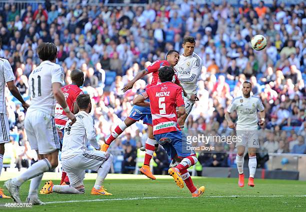 Cristiano Ronaldo of Real Madrid CF scores his team's 9th goal during the La Liga match between Real Madrid CF and Granada CF at Estadio Santiago...