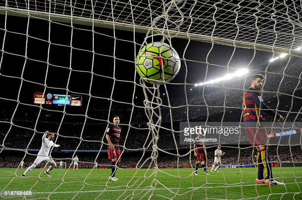 Cristiano Ronaldo of Real Madrid CF scores his team's second goal during the La Liga match between FC Barcelona and Real Madrid CF at Camp Nou on...