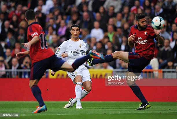Cristiano Ronaldo of Real Madrid CF scores Real's opening goal from a free kick during the La Liga match between Real Madrid CF and CA Osasuna at the...