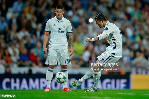 Cristiano Ronaldo of Real Madrid CF scores their opening goal during the UEFA Champions League group stage match between Real Madrid CF and Sporting...