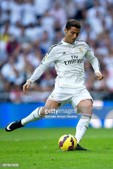 Cristiano Ronaldo of Real Madrid CF scores their opening goal from a penalty shot during the La Liga match between Real Madrid CF and FC Barcelona at...