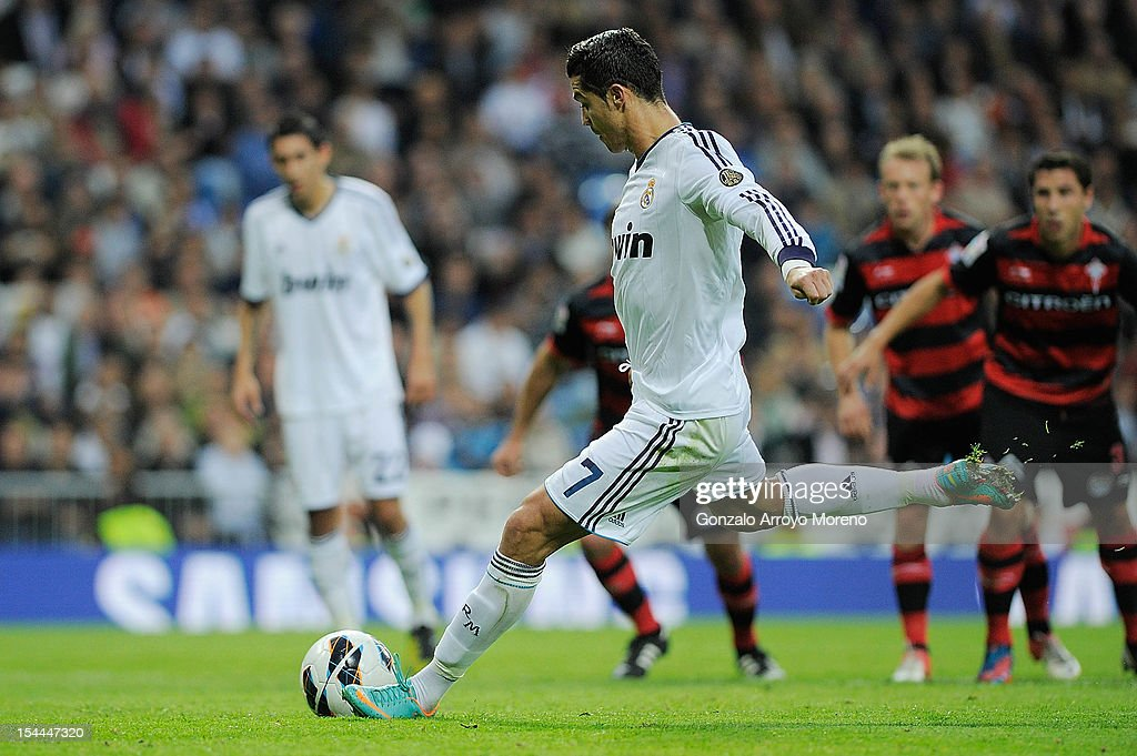 <a gi-track='captionPersonalityLinkClicked' href=/galleries/search?phrase=Cristiano+Ronaldo+-+Soccer+Player&family=editorial&specificpeople=162689 ng-click='$event.stopPropagation()'>Cristiano Ronaldo</a> of Real Madrid CF scores their second goal during the La Liga match between Real Madrid CF and RC Deportivo La Coruna at Santiago Bernabeu on October 20, 2012 in Madrid, Spain.