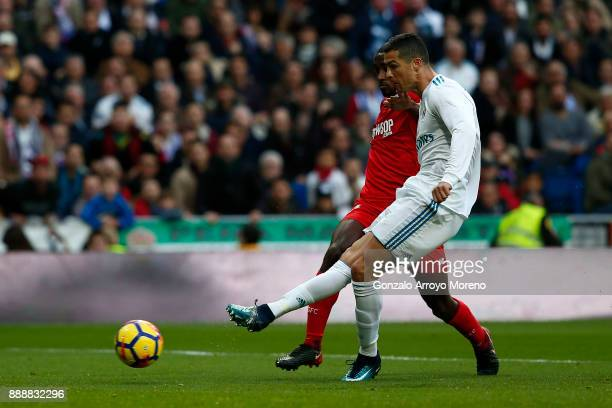 Cristiano Ronaldo of Real Madrid CF scores their second goal during the La Liga match between Real Madrid CF and Sevilla FC at Estadio Santiago...