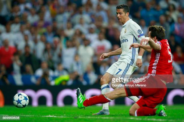 Cristiano Ronaldo of Real Madrid CF scores their third goal during the UEFA Champions League Quarter Final second leg match between Real Madrid CF...