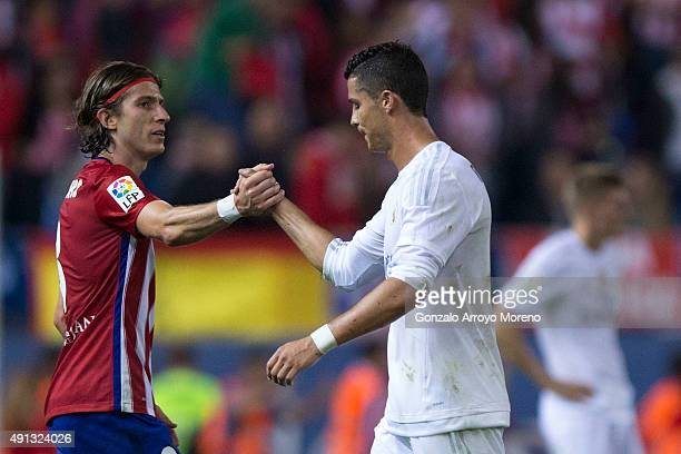 Cristiano Ronaldo of Real Madrid CF shakes hands with Filipe Luis of Atletico de Madrid as he leaves the pitch after the La Liga match between Club...