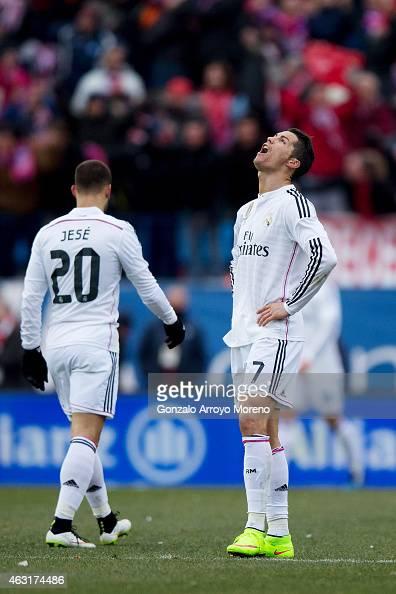 Cristiano Ronaldo of Real Madrid CF shouts defeated close to his teammate Jese Rodriguez as Mario Mandzukic of Atletico de Madrid celebrates scoring...