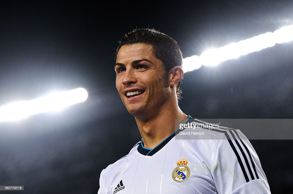 <a gi-track='captionPersonalityLinkClicked' href=/galleries/search?phrase=Cristiano+Ronaldo+-+Soccer+Player&family=editorial&specificpeople=162689 ng-click='$event.stopPropagation()'>Cristiano Ronaldo</a> of Real Madrid CF smiles during the Copa del Rey Semi Final second leg between FC Barcelona and Real Madrid at Camp Nou on February 26, 2013 in Barcelona, Spain.