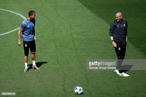 Cristiano Ronaldo of Real Madrid CF speaks with hi coach Zinedine Zidane during a training session ahead of the UEFA Champions League Semifinal...