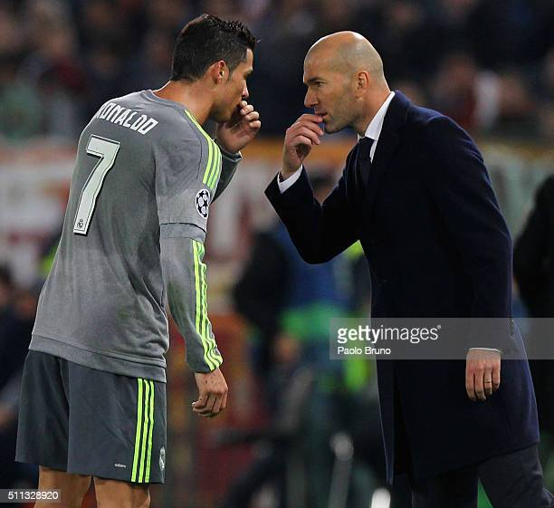 Cristiano Ronaldo of Real Madrid CF speaks with his head coach Zinedine Zidane during the UEFA Champions League round of 16 first leg match between...