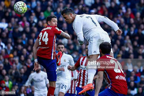 Cristiano Ronaldo of Real Madrid CF tries to score from a header during the La Liga match between Real Madrid CF and Club Atletico de Madrid at...