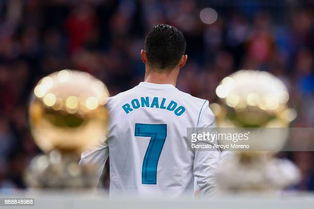 Cristiano Ronaldo of Real Madrid CF walks to the pitch after posing with his five Golden Ball trophies prior to start the La Liga match between Real...