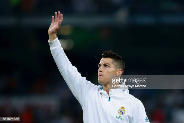 Cristiano Ronaldo of Real Madrid CF waves as he stands in formation prior to start the La Liga match between Real Madrid CF and Real Betis Balompie...