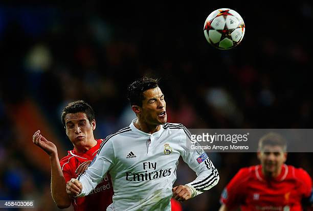 Cristiano Ronaldo of Real Madrid CF wins the header after Javier Manquillo of Liverpool FC during the UEFA Champions League Group B match between...