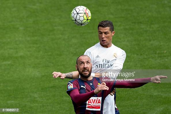 Cristiano Ronaldo of Real Madrid CF wins the header before Ivan Ramis of SD Eibar during the La Liga match between Real Madrid CF and SD Eibar at...