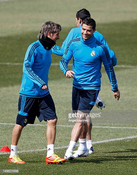 Cristiano Ronaldo of Real Madrid chats with Fabio Coentrao during a training session ahead of the UEFA Champions League Semi Final second leg match...