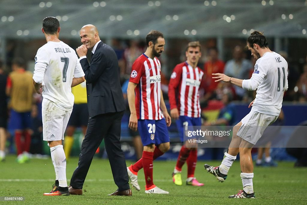 Cristiano Ronaldo of Real Madrid, coach Zinedine Zidane of Real Madrid, Gareth Bale of Real Madrid during the UEFA Champions League final match between Real Madrid and Atletico Madrid on May 28, 2016 at the Giuseppe Meazza San Siro stadium in Milan, Italy.