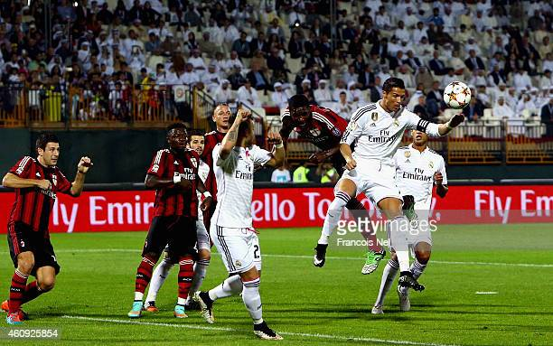 Cristiano Ronaldo of Real Madrid compete for the ball with Christian Zapata of AC Milan during the Dubai Football Challenge match between AC Milan...