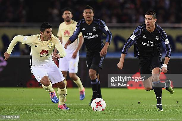 Cristiano Ronaldo of Real Madrid competes for the ball against Silvio Romero of Club America during the FIFA Club World Cup Japan semifinal match...