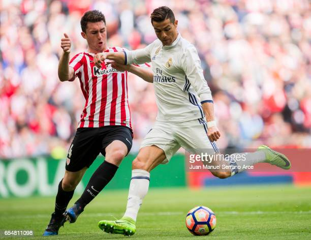 Cristiano Ronaldo of Real Madrid competes for the ball with Aymeric Laporte of Athletic Club during the La Liga match between Athletic Club Bilbao...