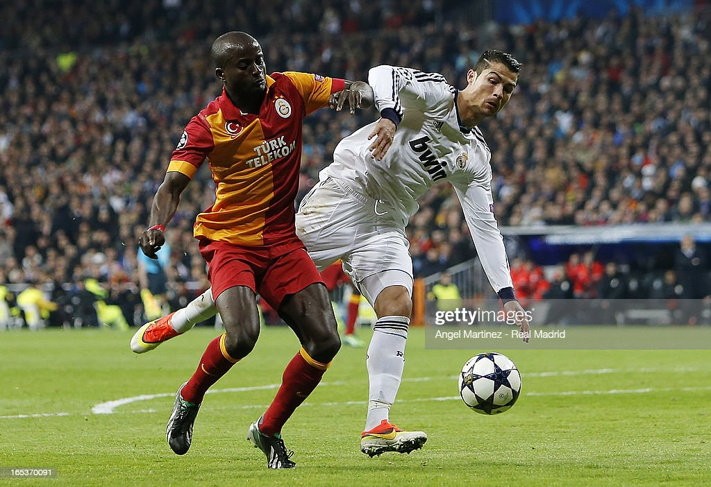 Cristiano Ronaldo of Real Madrid competes for the ball with Dany Nounkeu of Galatasaray during the UEFA Champions League Quarter Final match between Real Madrid and Galatasaray at Estadio Santiago Bernabeu on April 3, 2013 in Madrid, Spain.