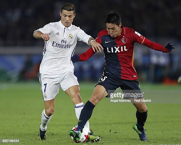 Cristiano Ronaldo of Real Madrid competes for the ball with Gen Shoji of Kashima Antlers during the FIFA Club World Cup Final match between Real...